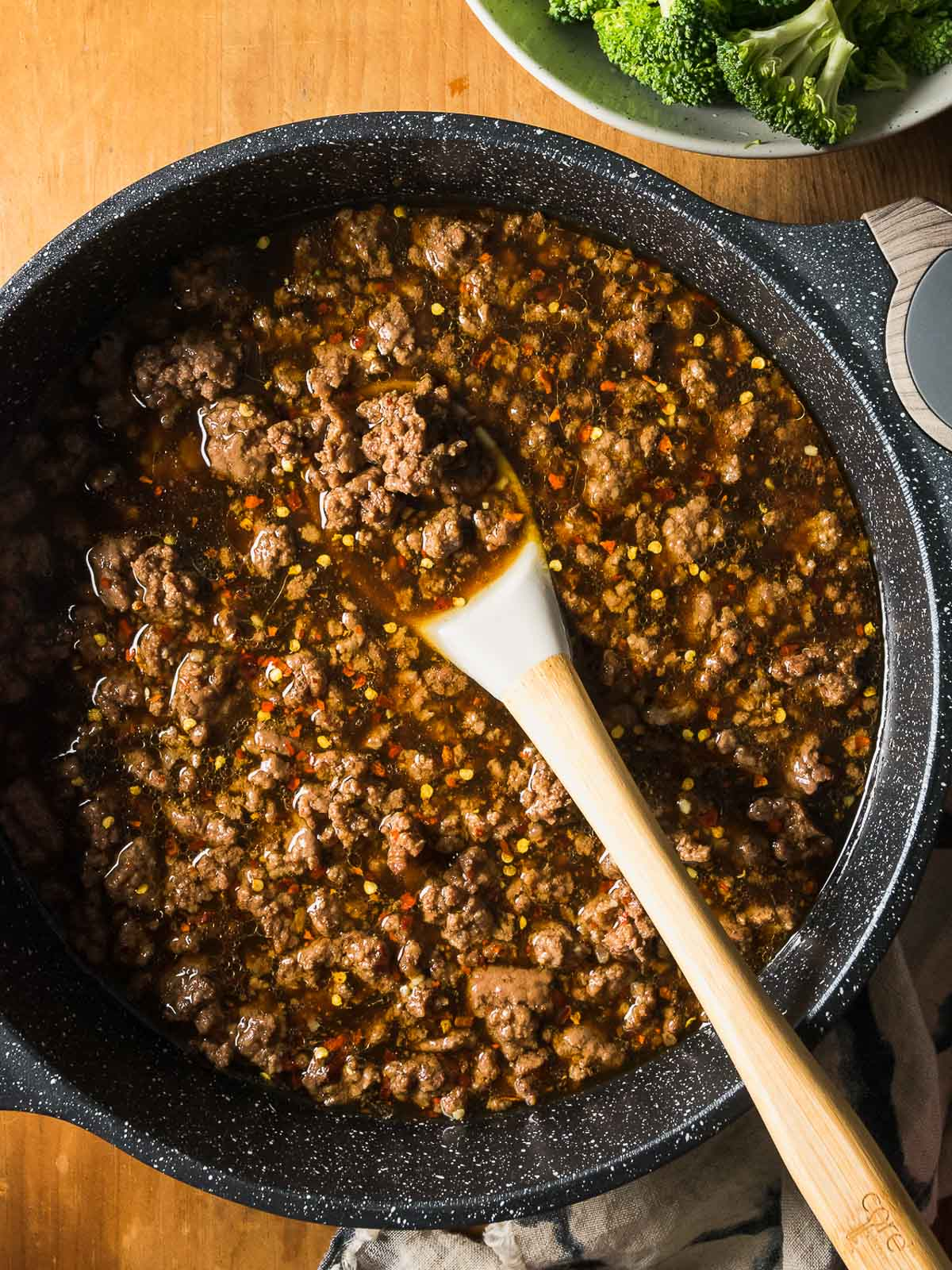 Making Ground Beef and Broccoli in a skillet.