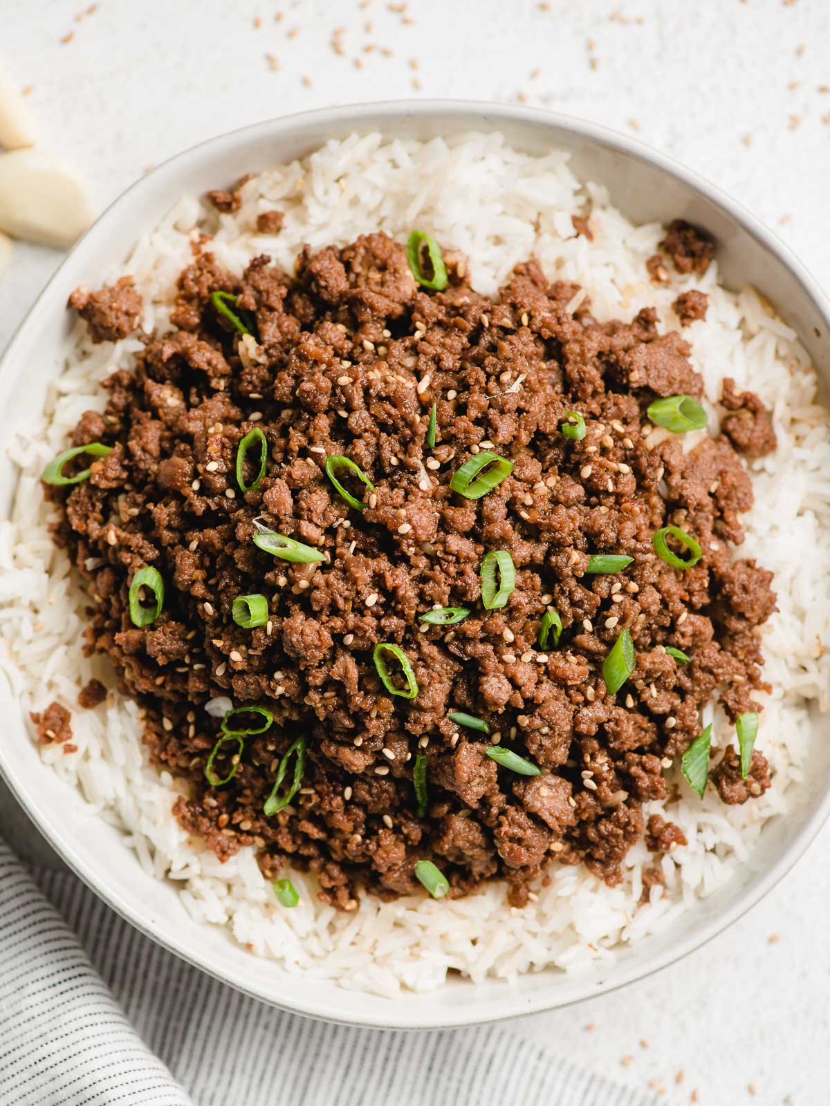Korean ground beef topped with green onions and sesame seeds.