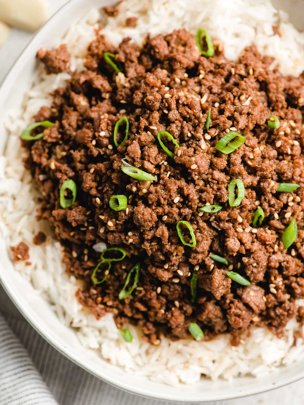 Top down image of ground beef bulgogi in a white bowl.