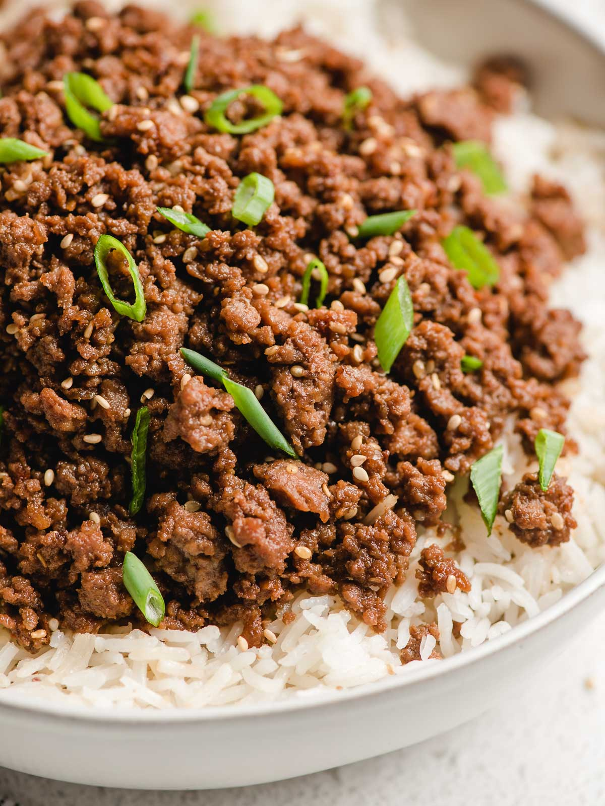 Ground beef bulgogi in a bowl with rice.