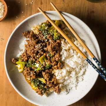 A bowl of Asian ground beef and broccoli on rice.