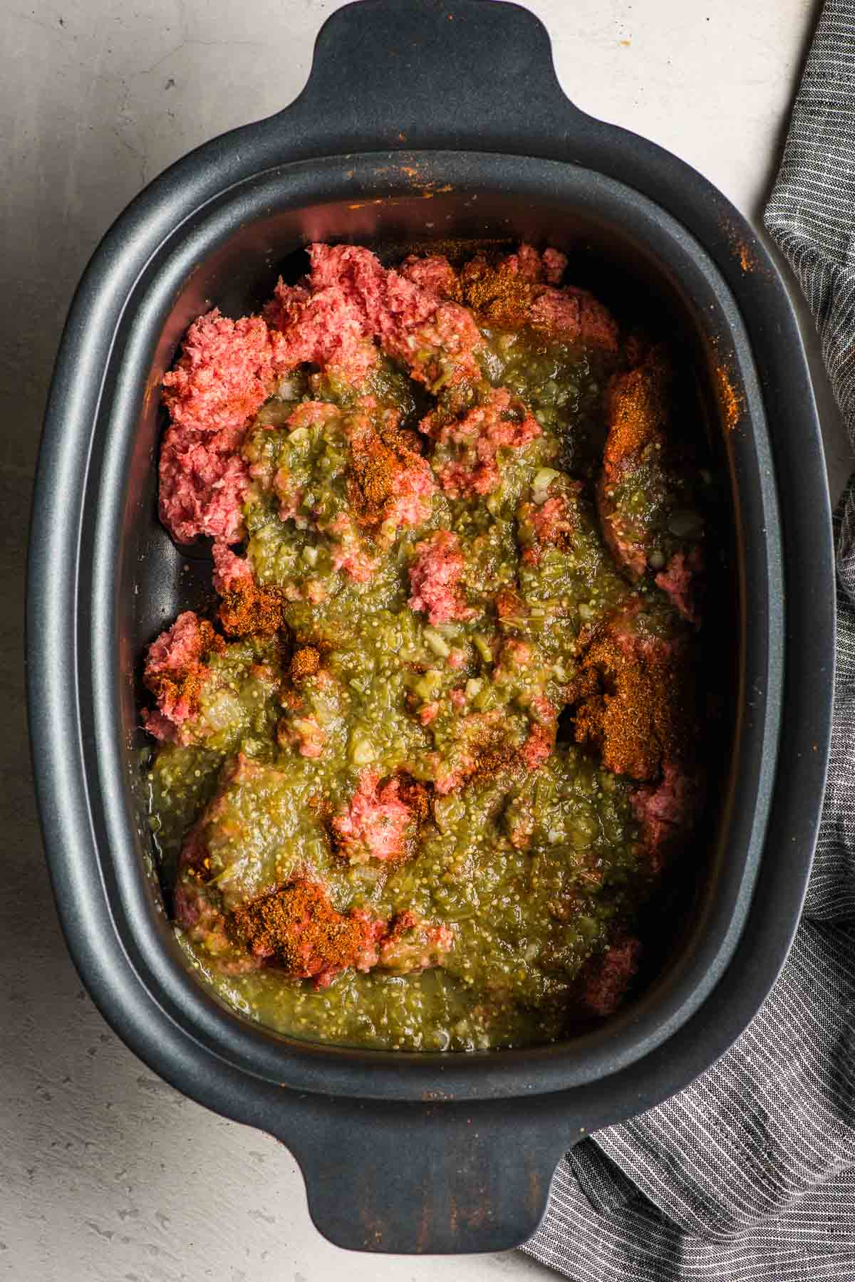 Slow Cooker Taco Meat ingredients in the crock pot.