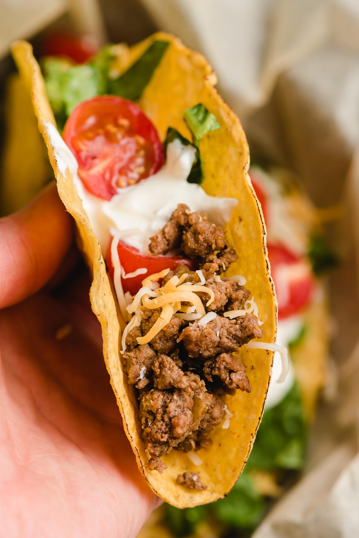 A crunchy taco with slow cooker taco meat inside.